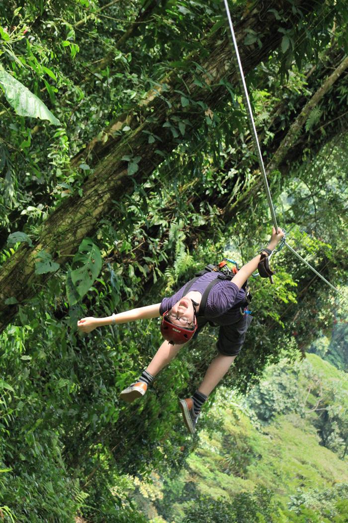 Hanging upside down from zipline in Costa Rica