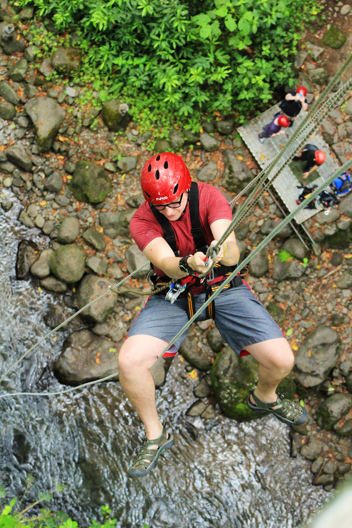 Repelling down to river bank for River Drift adventure in Costa Rica